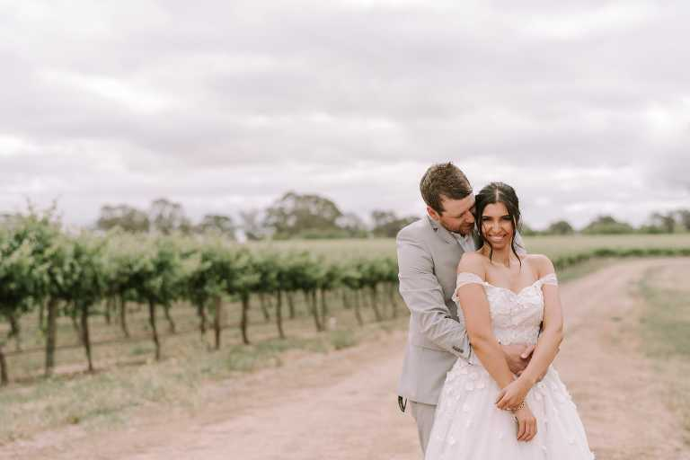 Bride lovingly held by Groom at Adelaide Hills Wedding photographed by Ivory Fox