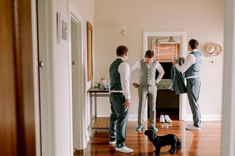 groom and groomsmen getting dressed