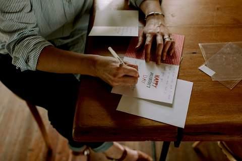 Bride writing groom card