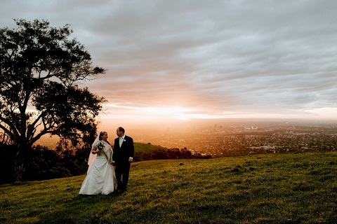 Couple walking at Mt Osmond at sunset