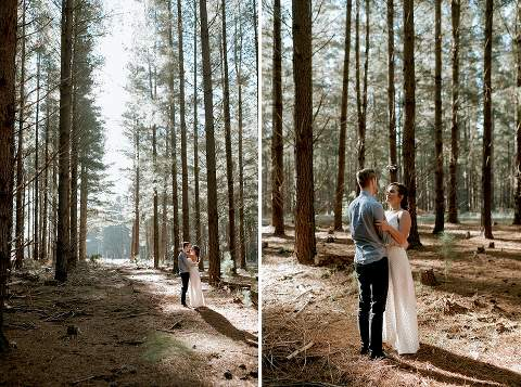 couple hugging in forest